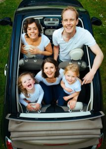 family in car happy due to notary public vehicle services